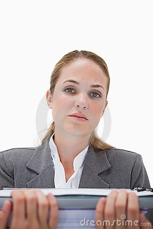 Frustrated office employee with pile of paperwork