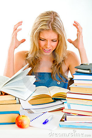 Frustrated teengirl with books tired of studying