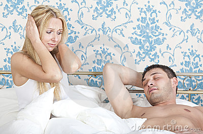 Frustrated woman with snoring man