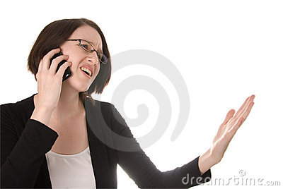 Frustrated woman talking on a mobile telephone