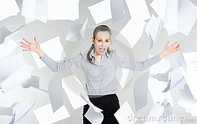 Desperate businesswoman with falling paper documents
