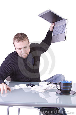 Frustrated Young Casual Businessman Working at his