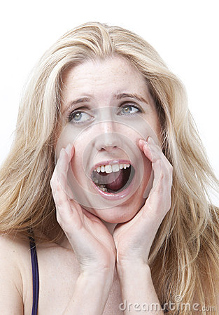 Frustrated young woman screaming against white background