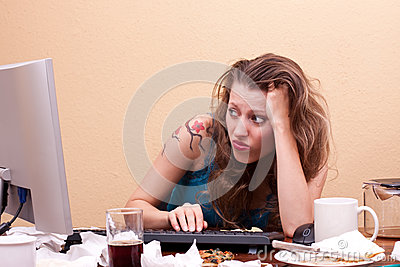 Frustrated young woman is sitting in front of the monitor