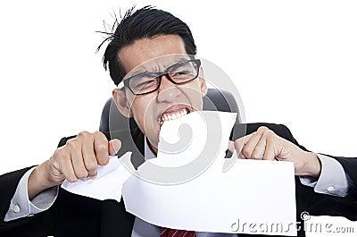 Frustration businessman tearing documents