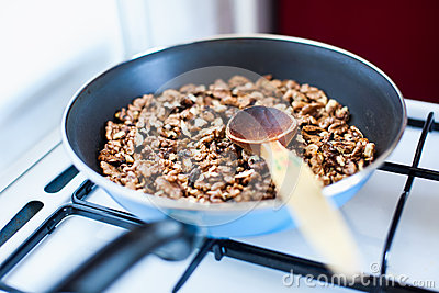 A frying pan with nuts