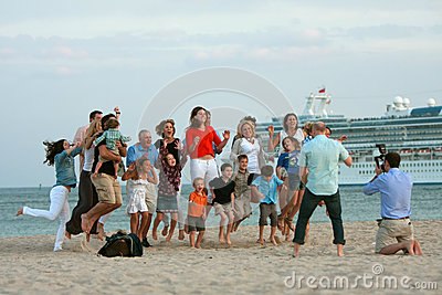 Large Family Jumps In Air While Photographer Takes Photo Editorial Stock Photo