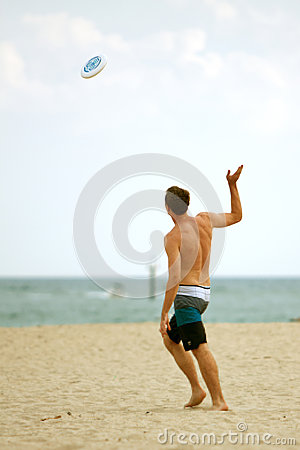 Man Throws Frisbee On Florida Beach Editorial Photo