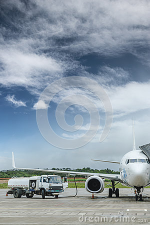 Fuel truck filling aviation fuel for plane Editorial Stock Photo