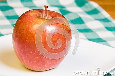 Fuji apple on a white plate