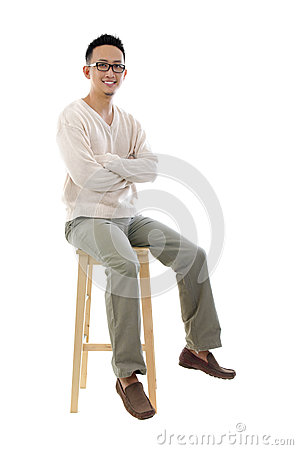 Free Full Body Asian Man Sitting On A Chair Stock Image - 26338411