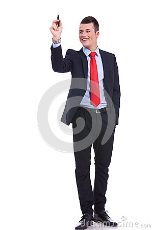 Full body picture of a business man writing
