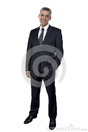 Portrait of a businessman on a globe made of money isolated on white background