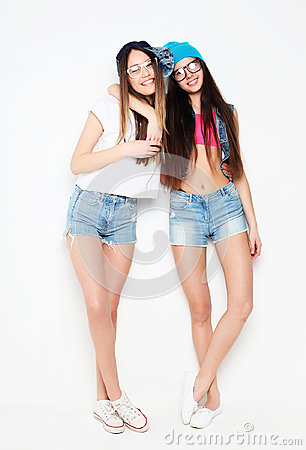 Free Full Body Portrait Of Two Hipster Girls Over White Background Royalty Free Stock Photography - 98502367