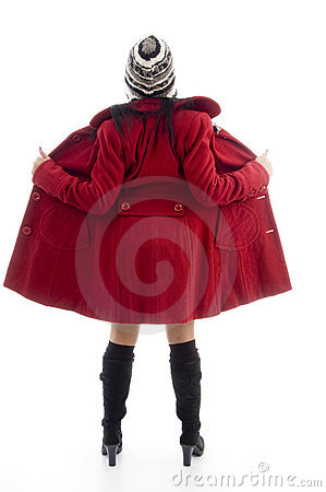 Full body pose of american woman in overcoat