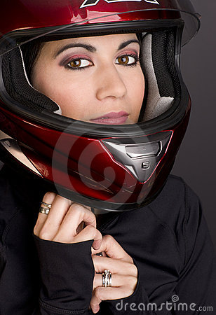 Motorcycle Rider Adjusts Red Full Face Helmet