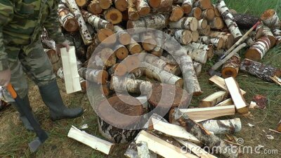 Full HD footage of a man choping firewood with axe stock video footage