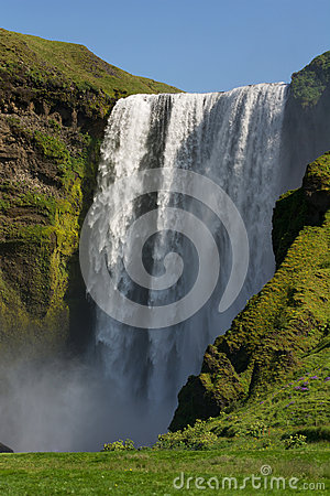 Full height view of Skogafoss waterfall, South Iceland