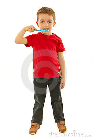 Full length of boy holding toothbrush