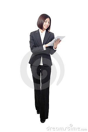 Full length businesswoman smiling using tablet pc