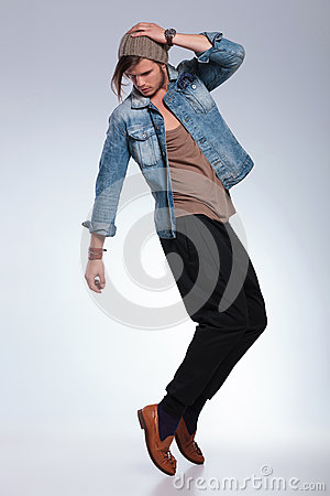 Full length of casual man balancing on toes