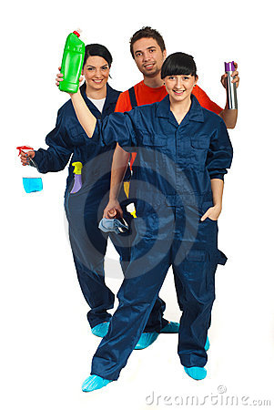 Full length of cleaning workers teamwork