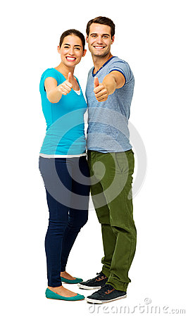 Full Length Of Couple Showing Thumbs Up Sign