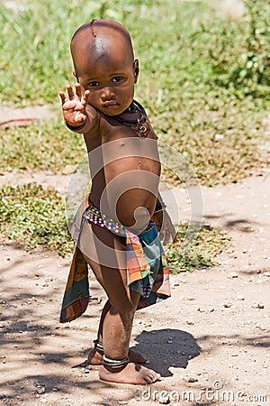 Full length of cute Himba boy Editorial Stock Photo