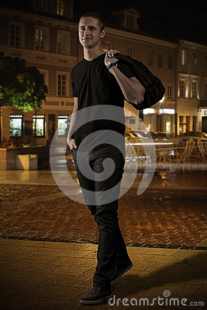 Man in black on the street at night