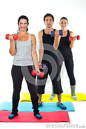 Full length of happy team doing fitness