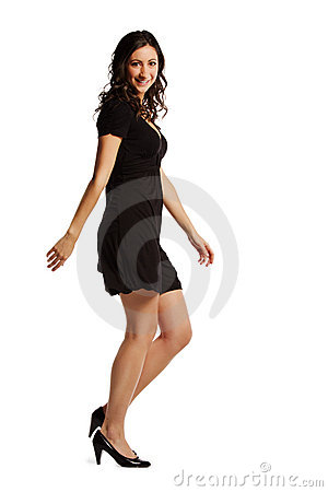 Full length image of confident young woman walking
