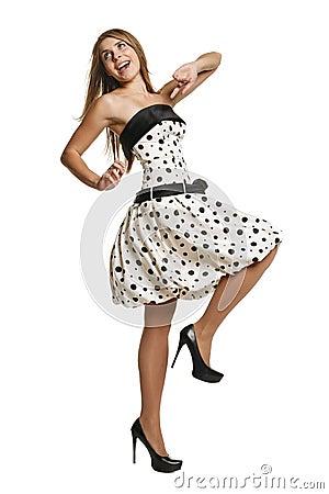 Joyful young girl walking in romantic dress