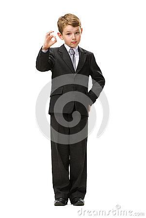 Full length of little businessman okay gesturing