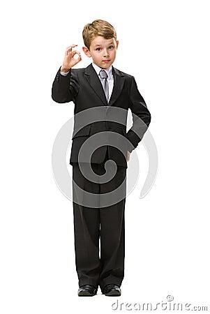 Full length of little businessman okay gesturing