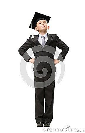 Full length of little student in academic cap
