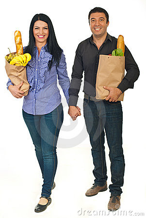 Free Full Length Of Couple Carrying Bags With Food Stock Image - 21940431