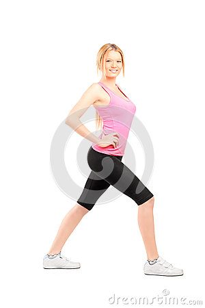 Full length portrait of an active young woman exercising