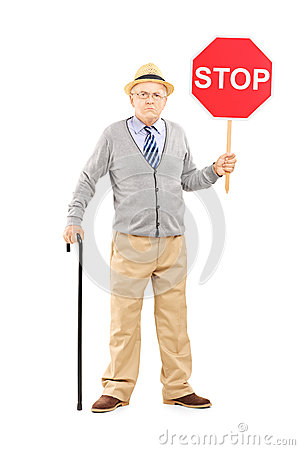 Full length portrait of an angry mature gentleman holding a stop