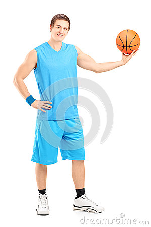 Full length portrait of a basketball player posing
