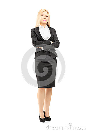 Full length portrait of a blond businesswoman looking at camera