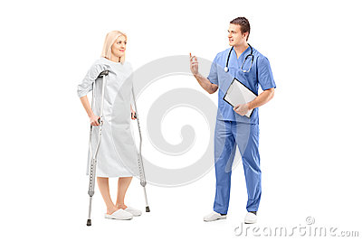 Full length portrait of a blond female patient in hospital gown