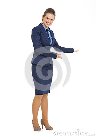 Full length portrait of business woman inviting