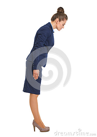 Full length portrait of business woman making asian greeting