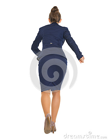Full length portrait of business woman running straight