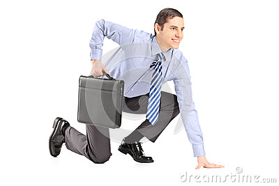 Full length portrait of a businessman with briefcase getting rea