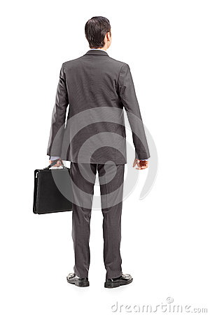 Full length portrait of a businessman with briefcase shot from b