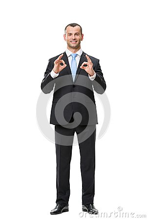 Full-length portrait of businessman ok gesturing