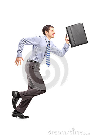 Full length portrait of a businessman running with a briefcase