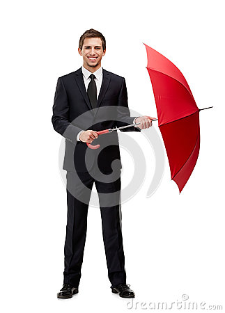 Full length portrait of businessman with umbrella