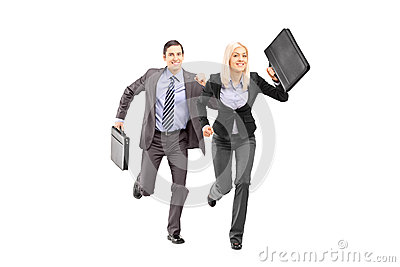Full length portrait of a businesspeople with briefcases running